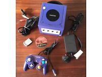 Purple gamecube console complete with game
