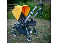 Bugaboo Bee 2010 (yellow) with baby cocoon, cosytoe, sunshade, rain cover and car seat adaptors
