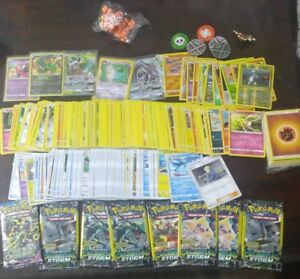 250 Pokemon Commons Cards (some Japanese), holos, dice, packs