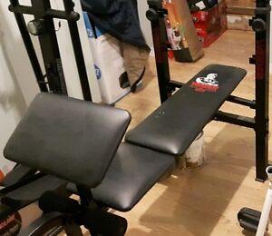 bench press + poids (weights)