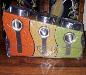 New sealed canister set with spoons and stand