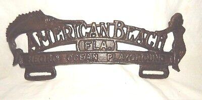 """AMERICAN BEACH FLA.  NEGRO OCEAN PLAYGROUND"" License Tag Fob CAST IRON FL  11"""
