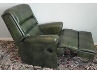 Leather Armchair with foot/leg rest extension.