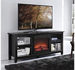 Tv stand with fire place .