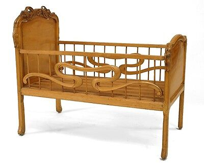 French Art Nouveau Carved Fruitwood Floral Design Crib with Spindle Sides