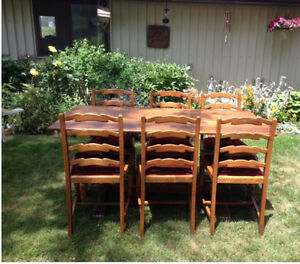 Oak trestle table with 6 ladder back chairs