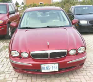 Smart looking Burgundy 2003 Jaguar X Type attracts attention.