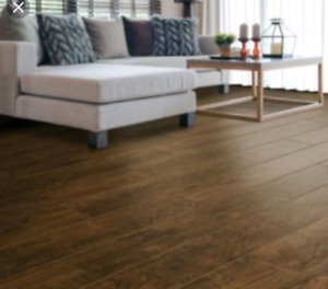 Gunstock solid oak prefinished hardwood flooring.