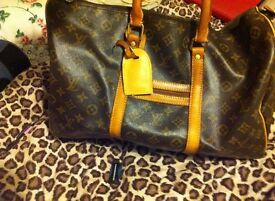 Louis Vuitton carry bag/holdall