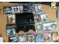 PLAYSTATION 500GB (PS3) CONSOLE WITH 2 CONTROLLERS AND 18 GAMES