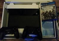 PS4 with two controllers and Assassin's Creed - Like new