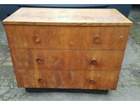 Brown chest of drawers.