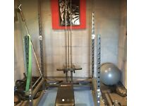 Power rack with cable attachment and bench