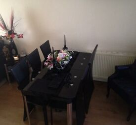Dinning room black glass extendable table