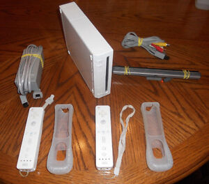 Nintendo Wii (Gamecube compatible) + controller , wires & games