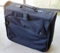 2 Suit folding wheeled suit case, used once