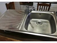 Kitchen sink with tap and fittings