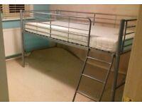 Children's metal bed frame and memory foam mattress.