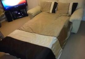 Good condition cream leather 2 seater sofa bed