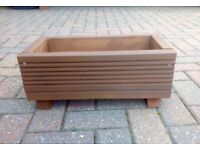 Small brown hand,are pre treated garden planter for sale. Made from garden decking