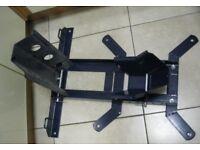 Heavy duty adjustable/versatile motorbike wheel chock