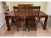 Solid oak dining table and four oak chairs