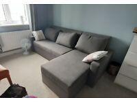 Corner sofa bed ( 4months old) with two storage and sleeping area, right/left handed