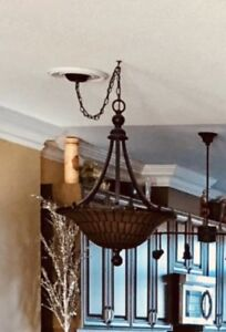 Hand painted antique bronze with amber glass light fixture.