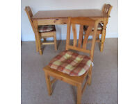 extending pine dining table and 4 chairs