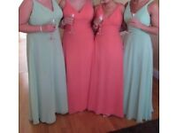 Four bridesmaid dresses, two coral and two mint