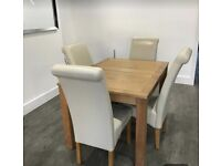 Immaculate condition dining room table with four cream chairs