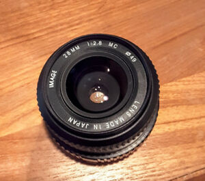 Prime lens 28mm  1:2.8  in excellent condt  come wth front cover