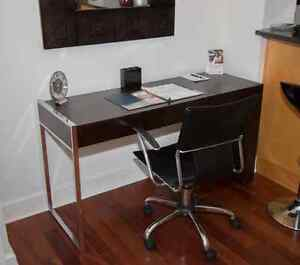 High end luxury desk with black leather swivel chair and Mirror