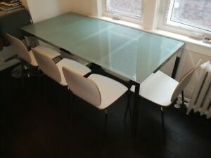 Glass top, chrome dining table and chairs