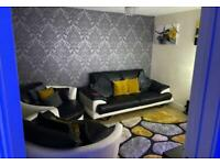 Black and white large leather sofa and 2 large cuddle chairs