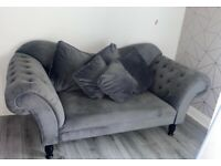 Grey two seater Chesterfield sofa