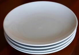 Four white china side plates