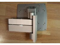Fully adjustable TV wall mount/plate