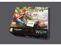 32GB Black Wii U Mario Kart 8 in original box. Under 12 mths old.