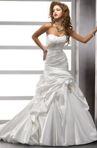 85% off - Blowout Wedding Dresses Sample Sale - Size 16-26
