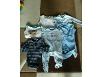 6-9 boys onesies. 4 onesies and 2 long sleeve vests