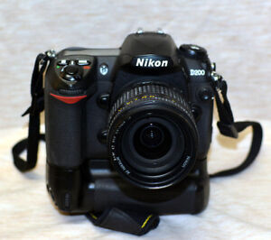 Nikon D200 with grip 2 lenses and more