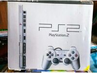 Boxed ps2 silver console with 10 games