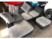 Black & grey corner sofa with foot stool