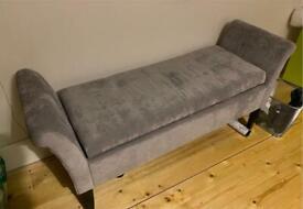 Grey velvet window seat with storage