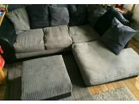 Grey and black corner sofa with footstool