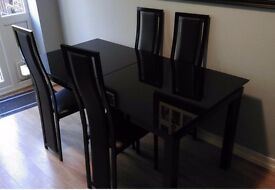 Extending black glass dining table and 4 chairs
