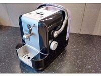 Lavazza Amodo Mido espresso machine with steam spout.