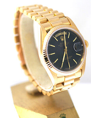 Rolex President DayDate Watch,In Yellow Gold, With Black Color Dial & Gold Bezel