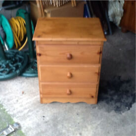Pine three drawer bedside unit